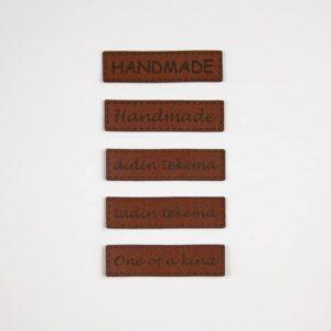 Ompelumerkki 50x15 ruskea